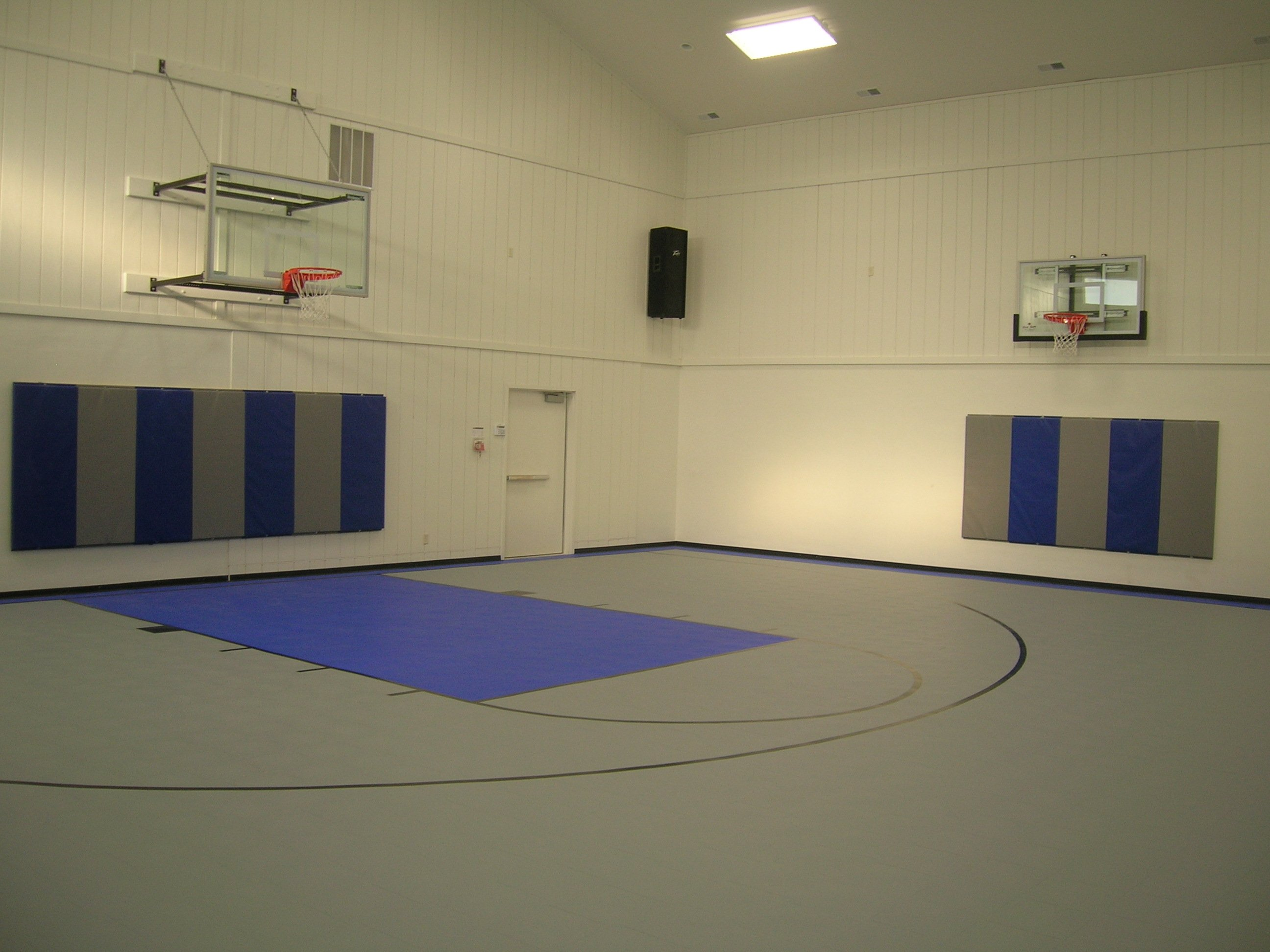 Indoor athletic flooring kcr enterprises llc for Indoor basketball court installation