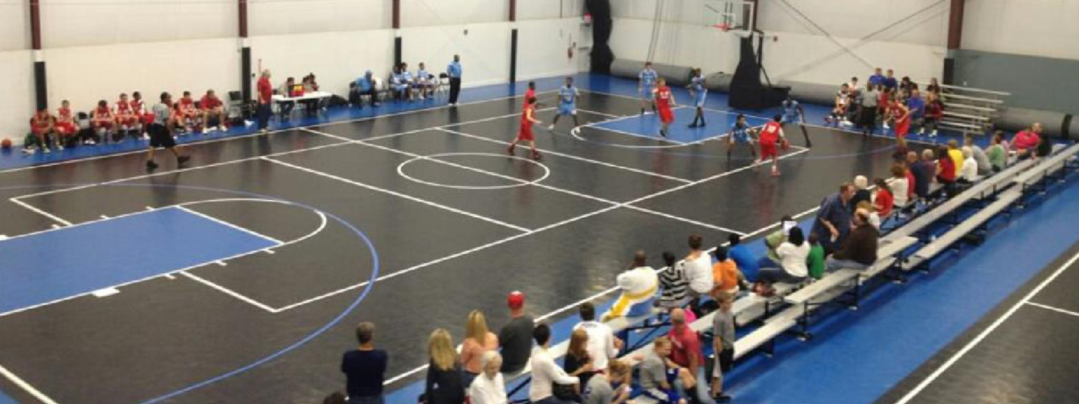 An indoor game of basketball